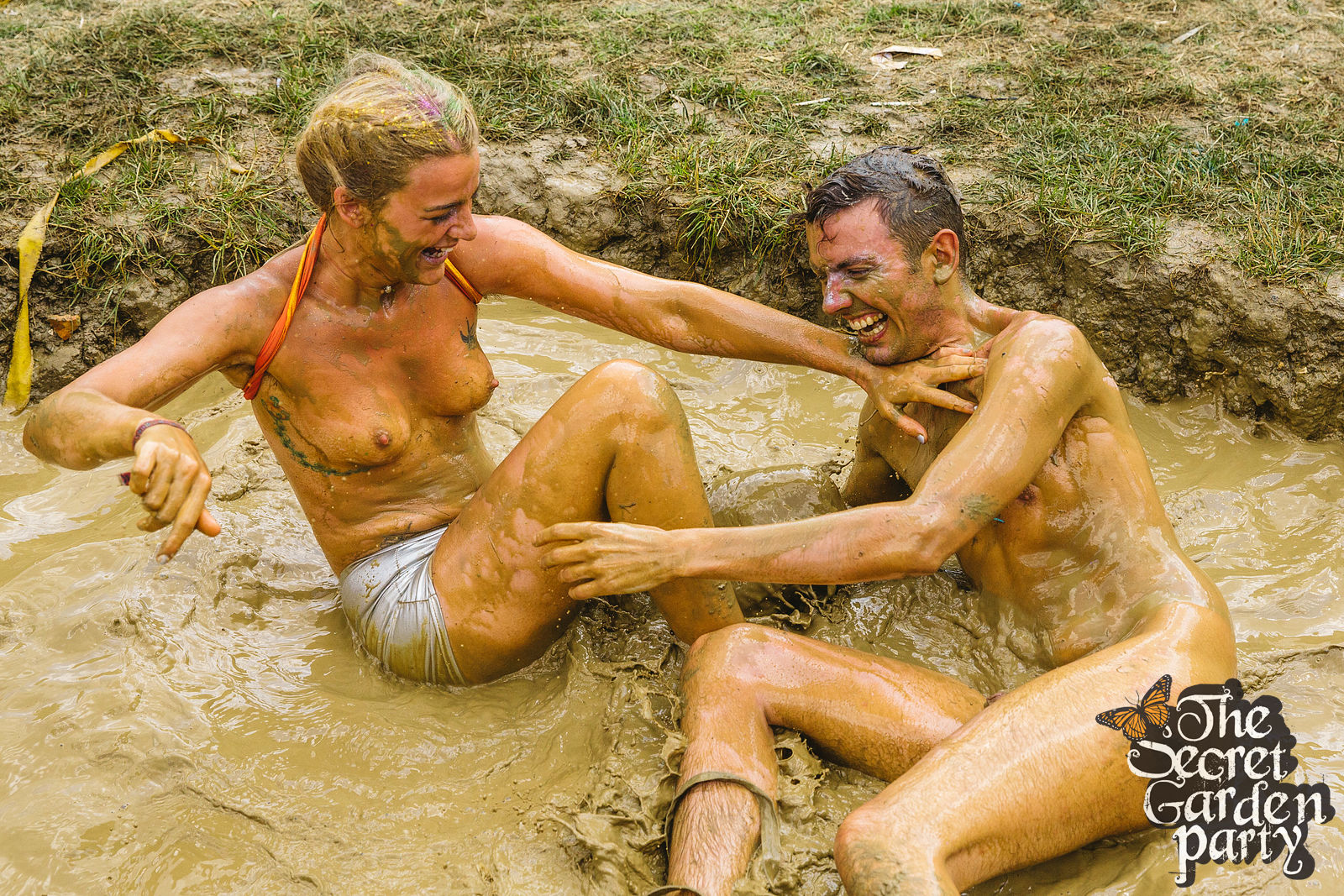 Male nude mud wrestling